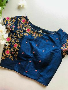 Mid-night blue color blouse adorned with very beautiful and intricate hand embroidery work. Contact for more customized designs and options. Pattu Saree Blouse Designs, Simple Blouse Designs, Fancy Blouse Designs, Bridal Blouse Designs, Back Design Of Blouse, Zardosi Work Blouse, Cut Work Blouse, South Indian Blouse Designs, Hand Work Blouse Design