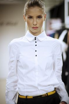 White button-down shirt with black buttons