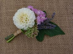 Buttonhole/Corsage made with White dahlia, Pink Statice, Lavender, Sedum and Ivy grown and made by Sussex cutting garden.