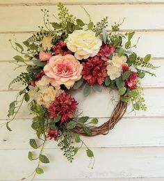 Elegance combined with country charm - this beautiful floral wreath has a romantic look with shades of rose, petal pink and ivory. Beautiful silk rose dahlias, full ivory and petal pink roses along with perk deep pink and buttercup cream hydrangeas present a delightful palette. The