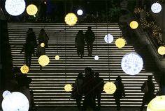 Visitors walk through Christmas lights at Tokyo Dome City in Tokyo, Japan