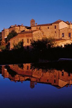 Castel Monastero, a converted medieval hamlet set deep in the Tuscan hills.