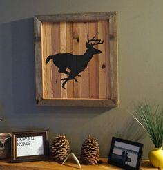 Rustic wall art of a deer running.  Would look good in a cabin, man cave, or house with farm house/rustic decor