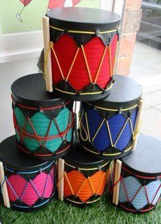 Kwanzaa: African Drum Craft for KidsAfrican drum craft for kids. Perfect for a Kwanzaa unit or Festival of Light.African drum craft to show ancient history.your weekly dose of crafty inspiration: July 2008 Drums For Kids, Music For Kids, Diy For Kids, Crafts For Kids, Music Crafts, Vbs Crafts, Diy Kwanzaa Decorations, Drum Craft, Instrument Craft