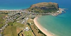Stanley Tasmania aerial view of The Nut and township. The famous nut remains from a volcanic plug deposited millions of years ago.