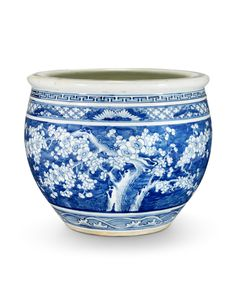 The jardinière is decorated in shades of cobalt blue with a continuous design of blossoming prunus trees in reserve on a blue ground above a band of waves to the base and below geometric bands to the shoulders. Blue And White China, Glass Ceramic, White Decor, Plant Decor, Chinese Art, Japanese Art, White Ceramics, Oriental, Artsy