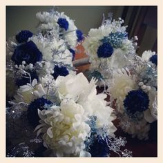silk flowers for a winter wedding ~ great for those outdoor pictures, no worry of frostbite.  Royal blue gowns for gals
