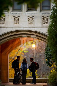 Students talk under the Lyons Hall archway.