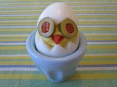 """Not only are these chicks delicious, but the end product is so cute. Kids can get in on the fun by helping you mash the egg yolk mixture, piping it into the egg white """"bodies"""" and putting the """"eyes"""" and """"beaks"""" on the chicks."""