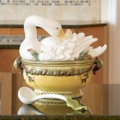 Goose Tureen & Ladle by Kaldun & Bogle. A coat of downy white feathers lends a stunning look to this gorgeous goose tureen.  Used as a fine centerpiece for the table or as a soup tureen this handpainted ceramic tureen with a crackle finish will certainly be a collector's favorite. It is such an elegant way to serve a winter soup, your guests will be delighted at the beauty of this tureen at the center of your table.  13