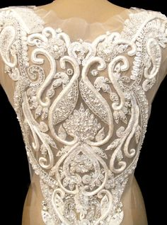 This bridal applique is full beaded and beautiful accessory for bridal dress.It has been decorate with rhinestone crystal and glass beads .It fits with