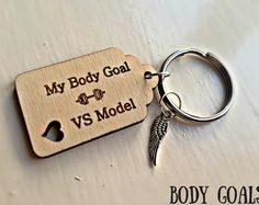 My Body Goal - Victoria Secret Model! Wooden Quote Slogan Tag and Feather Charm Keyring For Gym Motivation!  Tag - Material - Wood  Size - 40mm x 25mm  Feather - Material - Zinc Alloy  Size - 5mm x 17mm  Perfect for daily inspiration and motivation to reach your body goals!  All items are gift wrapped in a colourful organza bag with sequin confetti <3  Any questions, just ask