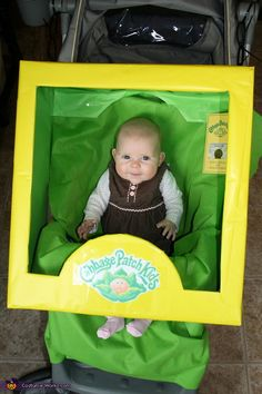 Cabbage Patch Baby Stroller costume creator:Baby costume built to fit stroller. Box, duct tape, zip ties, wrapping paper, blanket, printer, and cute baby!   Cut the box down to size needed leaving the back open, and the front shaped.  Cover box with wrapping paper, cut holes in blanket to fit straps for stroller.  Use zip ties to hold box to the stroller.