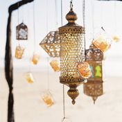 Is it Moroccan? Gypsy? Just bohemian? Lovely lighting on the beach. www.sittinginatreeblog.com - Our Work - gypsy love. katie neal photo.