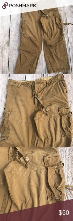 "Abercrombie & Fitch vintage cargo pants Khaki 36 Beautifully distressed and in vintage condition. These are amazing pants that hold their value due to their exceptional quality.   Brand: Abercrombie and Fitch Size: 36"" waist 30"" inseam  Condition: VGUC, no significant signs of use Abercrombie & Fitch Pants Cargo"