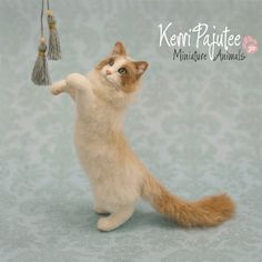 1:12 Dollhouse Miniature Ragdoll Cat 'Tassel'    This spirited Ragdoll cat was hand-sculpted in polymer clay over delicate wire armature and dressed in a luxurious coat of Alpaca fibers & powder-fine flock. This one-of-a-kind, animlated cat would stage beautifully in a variety of miniature settings, or displayed as a stand-alone piece of original miniature art.