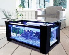 The aquarium is likely one of the decorations to embellish the appropriate home. With an aquarium able to presenting pure nuances into the home. The home is extra stunning and enticing. For present aquarium fashions, Types Of Coffee Tables, Black Coffee Tables, Unique Coffee Table, Coffee Table Design, Table Aquarium, Home Aquarium, Aquarium Fish, Fish Aquariums, Aquariums Super