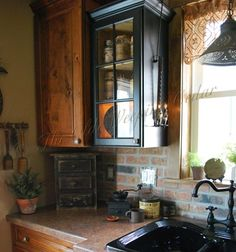prim kitchen corner mixing cabinets makes this small kitchen seem a little bigger.