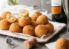 Cheesy Italian Arancini Balls -Creamy cheesy risotto rice, coated in panko and fried golden. The most EPIC Italian starter ever! www.recipetineats.com