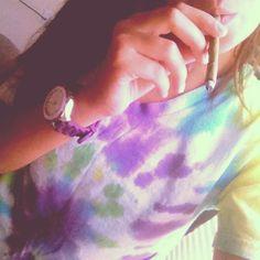 Smoking a blunt. Weed. High. Tie Dye. Hippy. 420