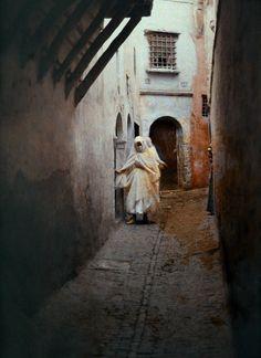 Two Moorish women walk in an alleyway, Algiers, Algeria, 1923