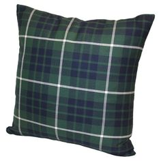 Add a pop of style to your sofa or favorite reading nook with this eye-catching cotton pillow, featuring a plaid motif. Made in the USA.
