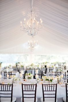 I love how the chairs pop against the backdrop of white, and the chandelier is to-die-for.