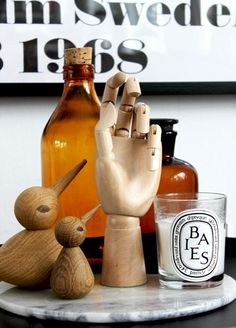 I love brown glass, Architectmade's birds, Diptyque's scented candle and ofcourse the wooden hand.