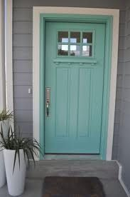 I want a turquoise front door SO BAD. And this is the perfect pin since I figured a gray house with white trim would work well for any color door. I would paint purple with my gray and white trim house. I really need a new door. Door Paint Colors, Best Paint Colors, Front Door Colors, Exterior Paint Colors, Paint Colors For Home, House Colors, Gray Exterior, Craftsman Door Exterior, Exterior House Colours