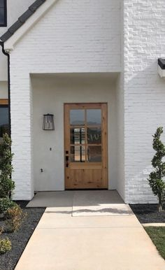 There is an exterior trend we've been loving--light wood entry doors.Today we have a beautiful roundup of light wood doors for every aesthetic to help inspire your own design. - May 30 2019 at Painted Exterior Doors, Painted Brick Exteriors, Exterior Paint, Exterior Design, Exterior Shutters, Wood Front Doors, The Doors, Entry Doors, Modern Front Door