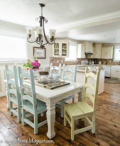 country cottage painted table and chairs mismatched and distressed bulky chairs go perfectly with this white distressed table via start at home new