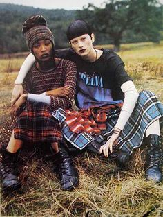 Tartan and biker boot grunge complete with band tees and a beanie hat.