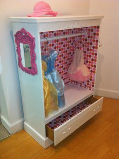 amazing little girls dress up hutch. I love how they wallpapered the inside and the cute little pink mirror hanging on the side. Its the little touches that make it work. Little Girl Dress Up, Kids Dress Up, Little Girl Rooms, Little Girls, Dress Up Wardrobe, Dress Up Stations, Dress Up Storage, Pink Mirror, Princess Room