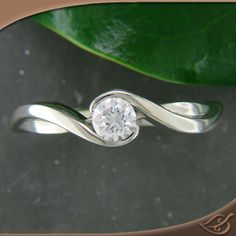 Half Bezel Wrap Mounting #jewelryworks #engagement Interesting mounting. Love the lines.