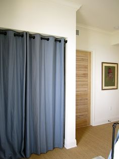 grommet curtains instead of closet doors. This is what I need to do in our Italy house.