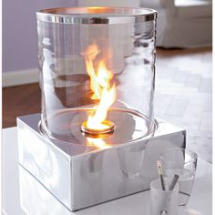 Table Fireplace. Cool idea.., but would be even better if table were more usable around the edges:)..bigger and with the shape I prefer:)