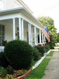 Google Image Result for http://us.123rf.com/400wm/400/400/deborahatl/deborahatl1008/deborahatl100800002/7525850-front-porch-with-an-american-flag.jpg