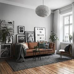 Scandinavian living room. Are you looking for unique and beautiful art photos or poster prints (not the ones featured in this pin) to create your gallery walls? Visit bx3foto.etsy.com and follow us on IG @bx3foto #decor #interiordesign #gallerywall #artwall #photoprints #artphotos #finephotography #posters #bx3foto
