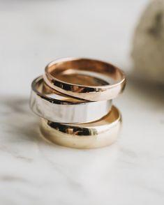 The options and combinations are endless for women's wedding bands, but did you know there are just as many choices with men's bands? Customizing a wedding band for him is such a special and personal way to wear your love story - after all, grooms deserve to pick out their dream ring too! We make it easy to choose your style, width, metal, color, finish and offer lots of ways to make his ring uniquely him. Wedding Bands For Him, Custom Wedding Rings, Dream Ring, Grooms, Solid Gold, Love Story, Choices, Rings For Men, Ink