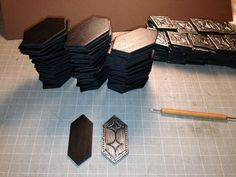A stack of scales for the Thorin Oakenshield costume armor shirt.  Made out of craft foam sheets.