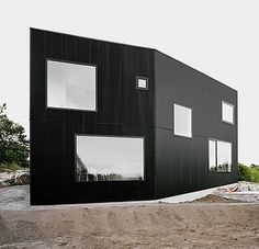 Private house located on the top of a hill overviewing the Atlantic archipelago. Cladding in black corrugated metal sheeting. House Tumle by Johannes Norlander Arkitektur Black Architecture, Architecture Design, Contemporary Architecture, Chinese Architecture, Architecture Office, Steel Cladding, Black Building, Design Case, Black House