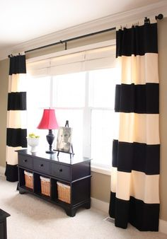 long curtains with a small shelf