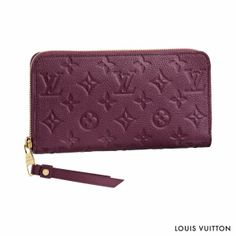 Exquisitely supple Monogram Empreinte leather adorns the classic shape of the Louis Vuitton Secret Long Wallet, making it a luxurious choice for the hoidays.