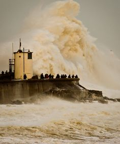 Waves smash into the wall at Porthcawl harbour, south Wales, on Wednesday