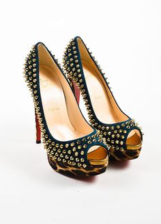 These rocker-chic pumps are constructed of deep peacock teal leather with pony hair platforms and heels in a leopard print. Almond shaped peep toes. Metallic toe beds. Features gold toned spikes throu