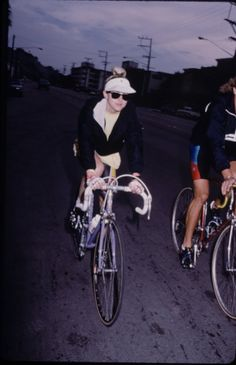 Singer Madonna and unident. trainer on bicycles.