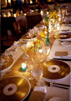 Golden records as place settings made by spraying found records gold and adding…