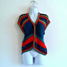 "$15 - Vintage 80s Colorful Striped Sweater Vest - Size L - Fun vintage vest in great condition! Fantastically eye-catching stripes. Buttons up front (no button holes; buttons go through knit). Two pockets. Great chunky knit. Great for layering or wearing alone. Bust - 38"" (stretchy) Waist - 37"" (stretchy) Length (shoulder to hem) - 22"" Size - Vintage L; estimated modern L (PLEASE CHECK MEASUREMENTS) Label - Rosanna Materials - Cotton Color may vary slightly. #80sfashion #80sstyle…"