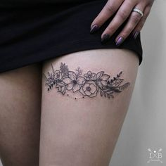 Flowers floral garter tattoo by Irene Bogachuk
