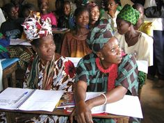 These women are in an adult literacy class in Guinea, a country in West Africa, as part of the Community Participation in Education for Equity and Equality project.